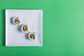 Japanese sushi on a green background. Minimalism style