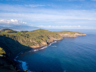 Aerial view of the cliffs and coves by the coast in the Azores, Portugal.