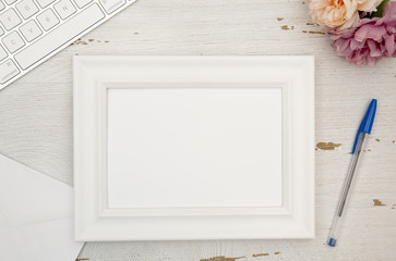 Empty Picture Frame on a Wooden Desk