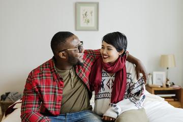 A cheerful couple enjoying Christmas holiday