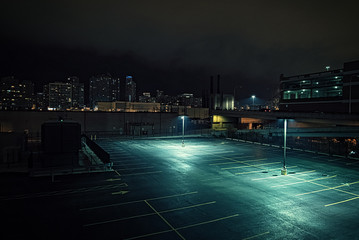 Wall Mural - Big deserted urban city parking lot and garage at night in Chicago.