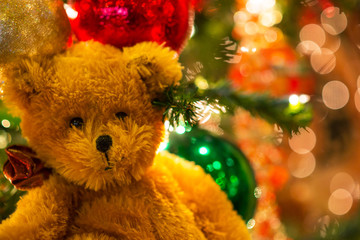 Cute teddy bear and Christmas ornaments