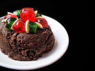 Christmas pudding on black background