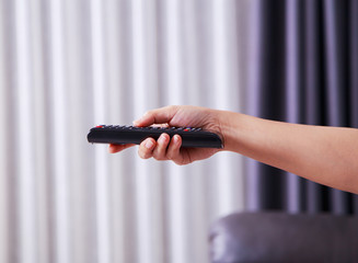 remote tv in hand