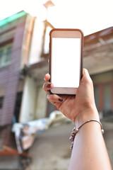 woman's hand holding smartphone take photo.