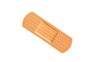 Single adhesive bandage on white background