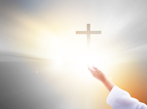 Confidence Concept: A child reaches out and touches the cross of Christ Jesus