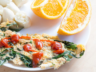 Vegetable omelet with ketchup