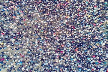 View from the height of the crowd of people on the asphalt