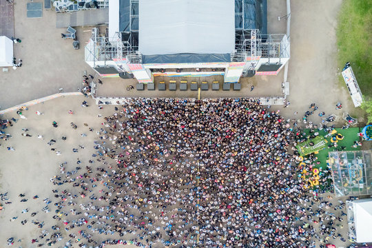 View from above of a crowd of people near the stage