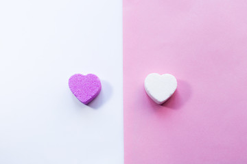White and pirple candies in shape of heart