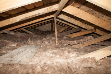 mineral wool in the attic of the house Foam plastic Insulation of a new home on a new roof