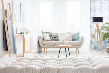 Grey mattress in living room