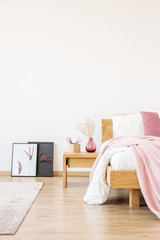 Pink bedroom with handmade posters