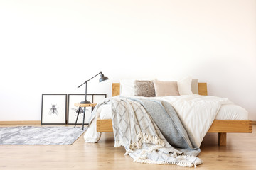 Wooden king-size bed in bedroom