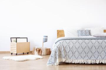 White rug in simple bedroom