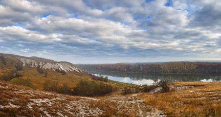 Autumn landscape. Cretaceous hills of the Don River. View on the pond on a background of cloudy sky.