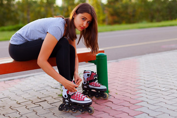 Teen girl dresses roller skates