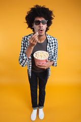 Full length portrait of a surprised afro american man