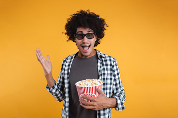 Portrait of a cheerful afro american man in 3d glasses