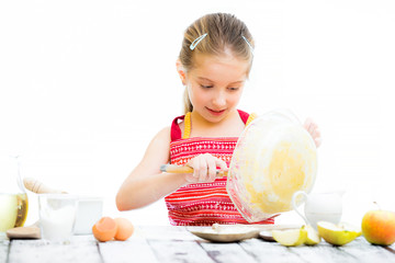 cutre little girl making dough isolated on a white background