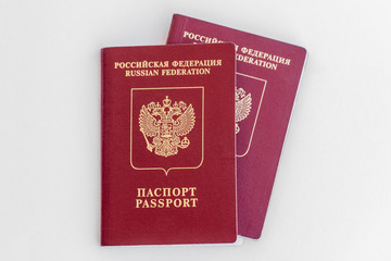 Two red Russian passports on a white background. Isolated