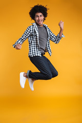 Full length portrait of a happy young african man jumping