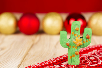 Holiday green cactus on christmas background