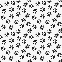 Dog paw print vector seamless pattern