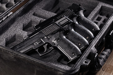 black handgun in plastic Secure Storage Case