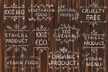 Hand drawn VECTOR elements on light wooden background. Black lines. Bio, organic, ethical products.