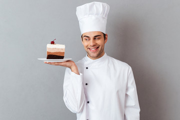 Portrait of a smiling male chef dressed in uniform