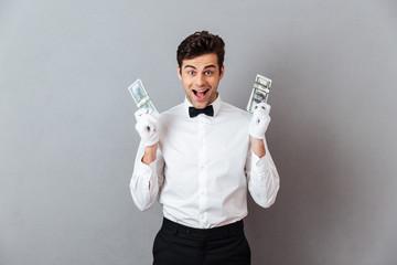 Portrait of a happy successful male waiter