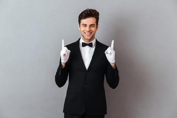 Portrait of a smiling friendly man dressed in tuxedo