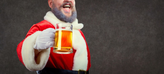 Santa Claus with a mug of beer in his hand at Christmas on a background of copyspase.