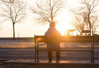 woman alone at sunrise