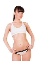 beautiful young woman with slim body in underwear isolated