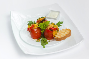 Tomatoes stuffed with meat and cheese, with greens sour cream