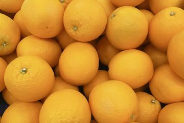 Organic fresh mandarin orange in fruit market.Orange freshness fruit background.