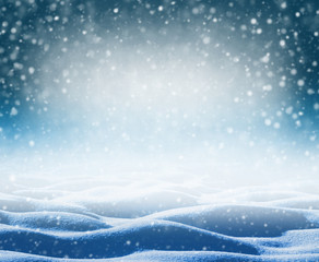 Winter bright background. Christmas background with snowdrifts and falling snow