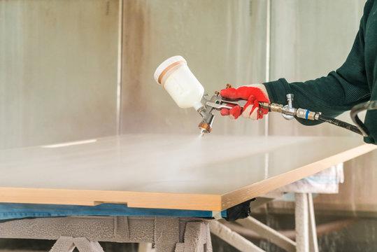 Staining wood with spray gun