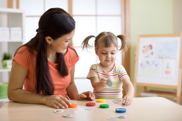 Mother with kid having fun time together