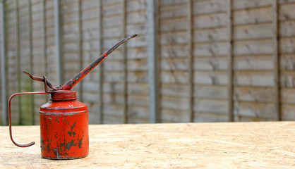 Oil can on a workbench