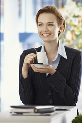 Happy businesswoman with coffee cup