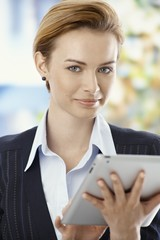 Beautiful businesswoman using tablet pc