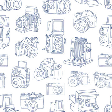 Monochrome seamless pattern with old and digital photo cameras hand drawn with blue contour lines on white background. Vector illustration in doodle style for wallpaper, wrapping paper, backdrop.