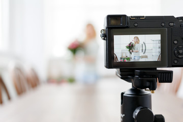 Defocused photo of florist woman writing to camera master class