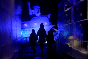 Ruby Darragh, 3, Gabriella Nijjer, 6, and Jack Drury, 3, walk past ice sculptures at the launch of Hyde Park Winter Wonderland's Magical Ice Kingdom in London