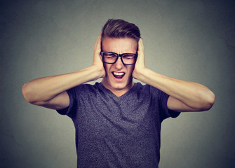 stressed man frustrated can't tolerate anymore loud noise. Negative human emotions