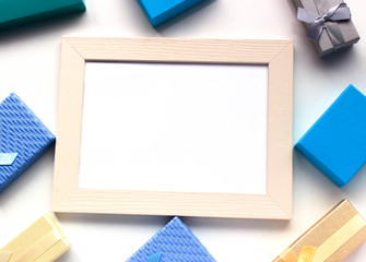 Gift boxes around the frame with empty white paper